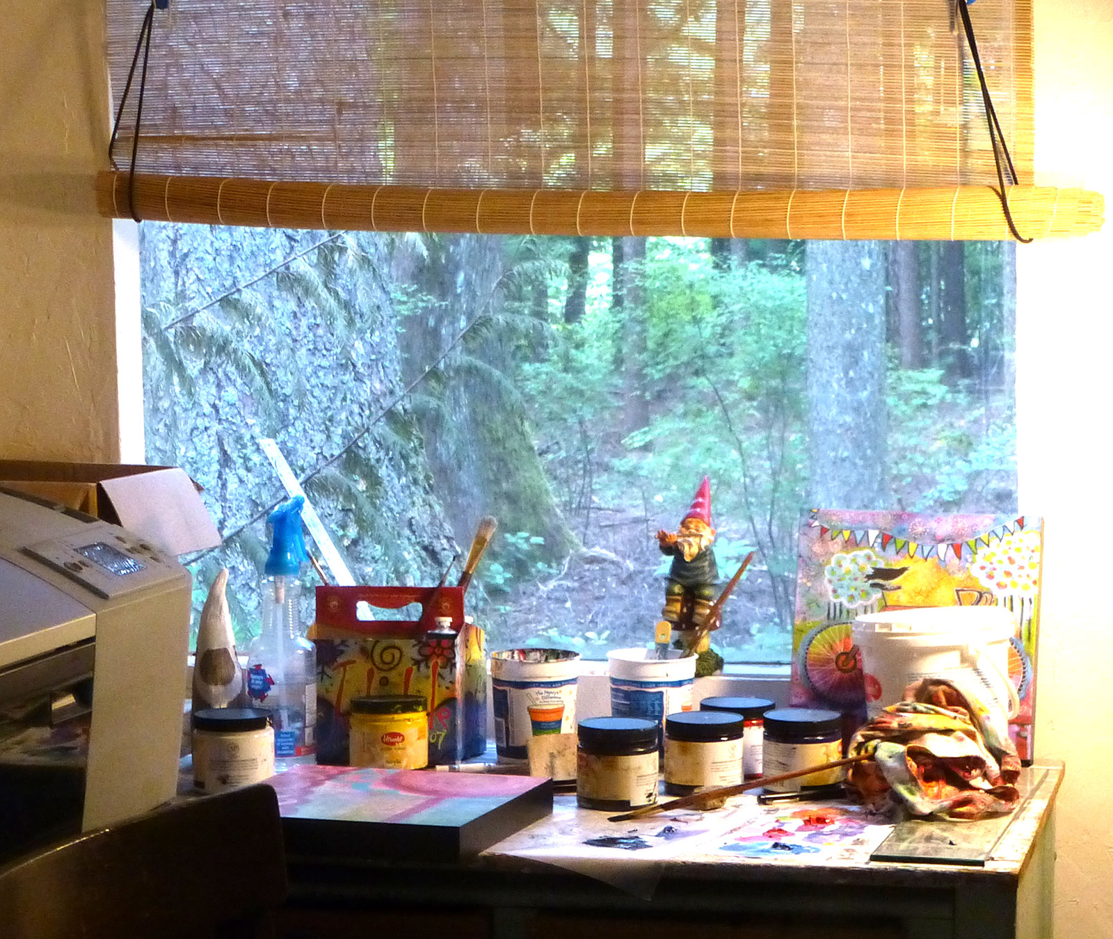 art studio window with forest
