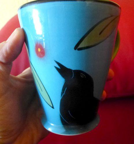 Blue raven mug by Natalie Warrens